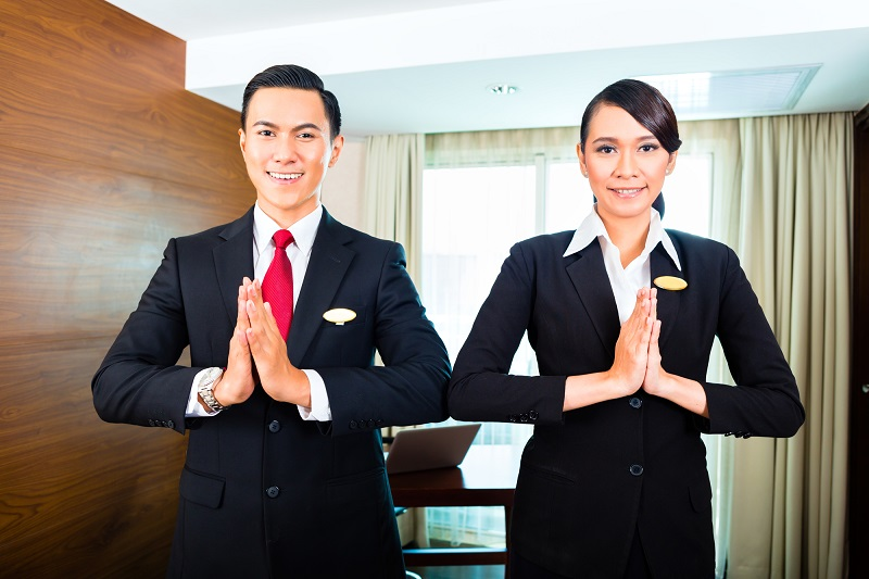 Staff greeting guests in Asian hotel