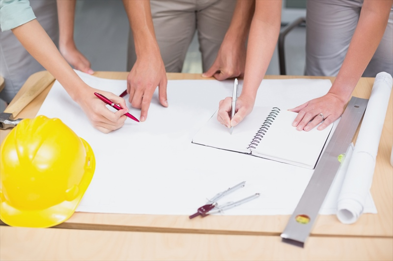 Architecture team working together at desk in the office